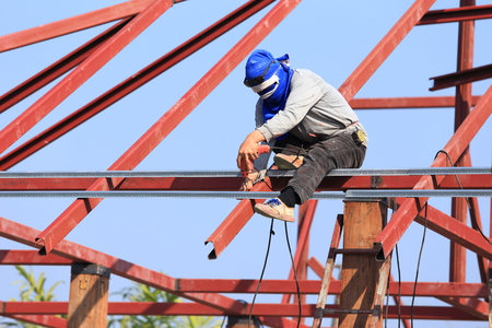 labor working in construction site for roof prepare  photo