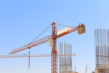 Building crane and construction site under   blue sky  photo