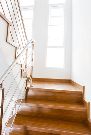 Interior wooden staircase of new house photo