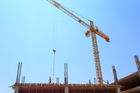 Construction Site with crane on blue sky  photo