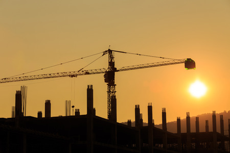 silhouettes Construction Site with crane on sunset photo