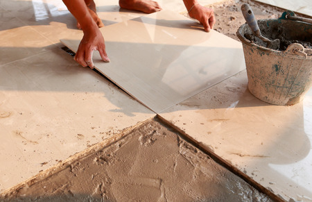 floor tile installation for house building  Stock Photo