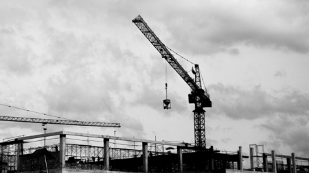 buildingsite: Construction site with cranes on silhouette