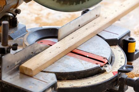 carpenter cut wood for house construction  photo