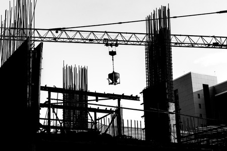 Construction site with cranes on silhouette background Stock Photo