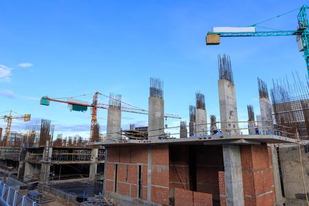 Building crane and construction site under blue sky  photo