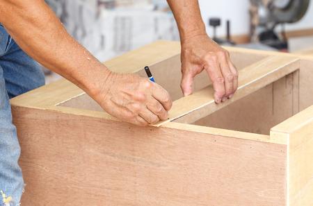 carpenter make new furniture for house photo