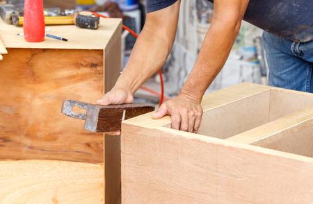 carpenter used planer for make new furniture for house photo