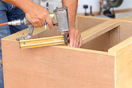 carpenter used air-gun for make new furniture  photo