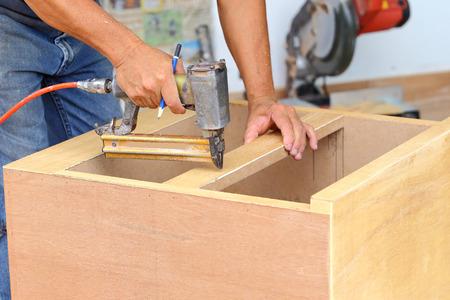 carpenter used air-gun for make new furniture  스톡 콘텐츠