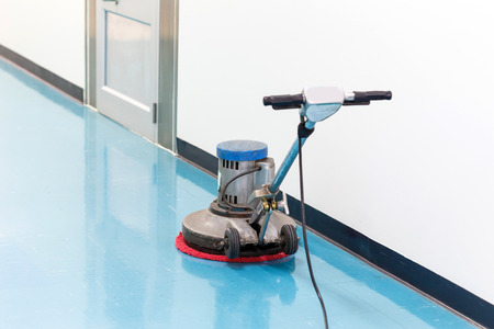 cleaning an office: clean floor machine  Stock Photo