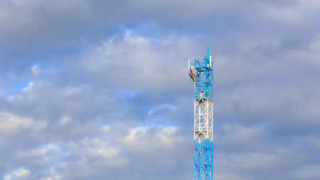 high frequency: Worker working on communication tower