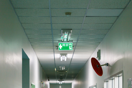 fire exit sign: Fire exit sign in factory Stock Photo