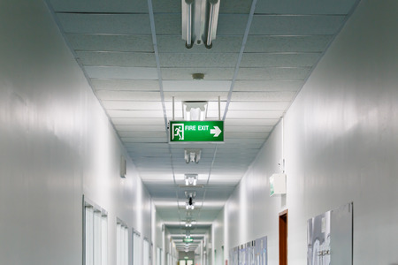 Fire exit sign in factory photo