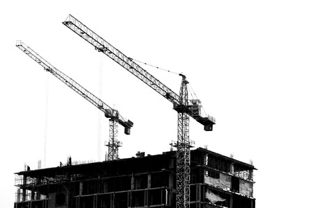 buildingsite: Construction site with cranes on silhouette background