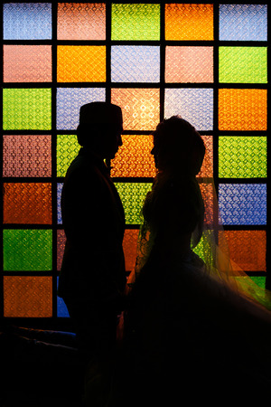 Silhouette romantic Scene of love muslim couples on colorful wall  photo