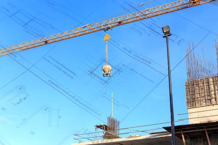 buildingsite: Building crane and construction site under blue sky Stock Photo