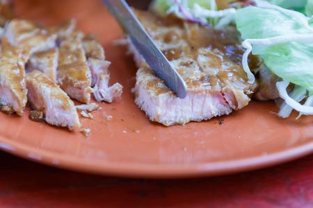 grilled pork steak with salad