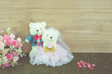 Romantic toy Bear in wedding scene photo