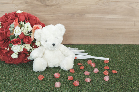Bear toy with candy and rose photo