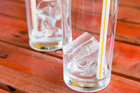 rad: ice in glass on rad wooden table