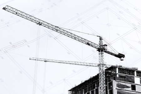 site: Construction site with cranes on silhouette