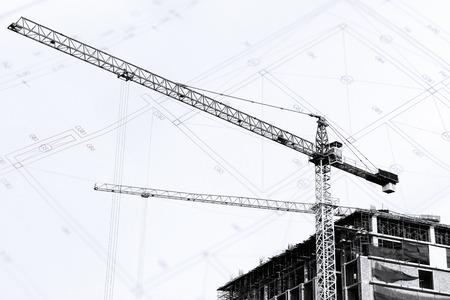 materiales de construccion: Obras de construcci�n con gr�as en silueta