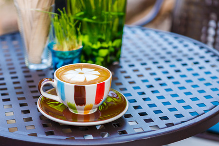 Latte coffee cup on table in cafe photo
