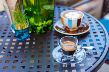 Americano coffee cup on table in cafe photo