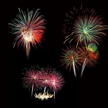 Set of colorful fireworks light on the black sky photo
