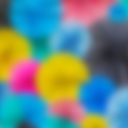 Colorful circle paper pattern with blur filler photo