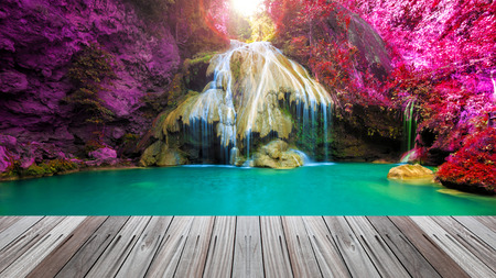 wonderful waterfall in thailand  with wooden floor photo
