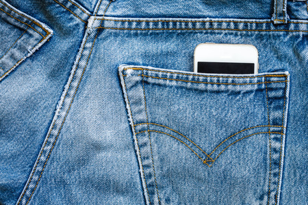 jeans bag with mobile smart phone photo