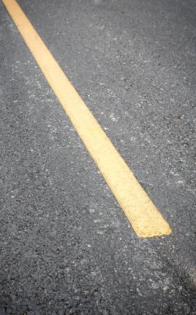 yellow line: Yellow line on road texture Stock Photo