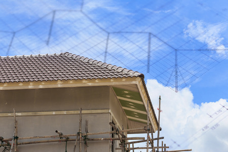 work worker workforce world: scaffold support for house building Stock Photo