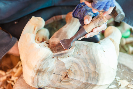 carver: Hand of carver carving wood Stock Photo
