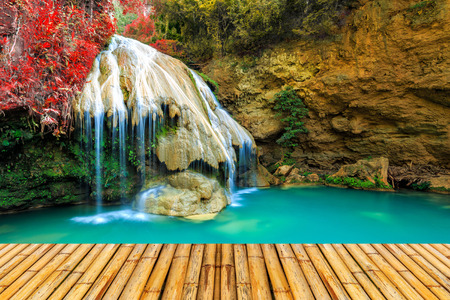 wonderful waterfall in thailand with bamboor floor