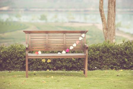 Wooden Chair in garden photo