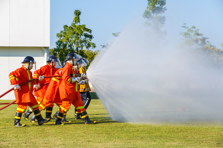fire safety: Firefighter fighting for fire attack training Stock Photo