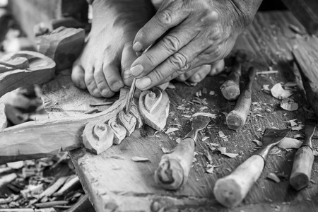 carver: Hand of carver carving wood in blackand white color tone Stock Photo
