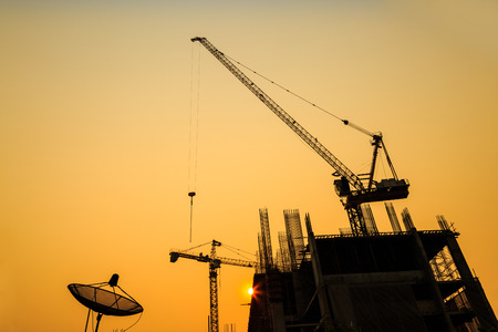 Construction site with cranes on silhouette background 스톡 콘텐츠