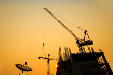 Construction site with cranes on silhouette background Archivio Fotografico