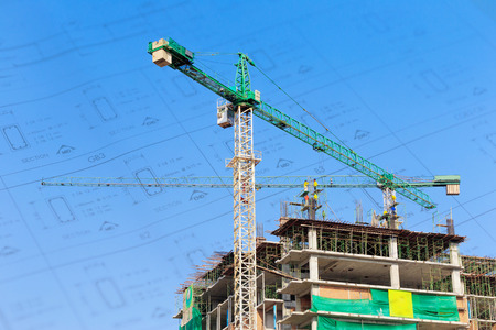 building site: Construction site with crane and workers on blue sky