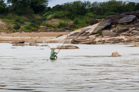 lao: LAO - MARCH 27 2015: Local fisherman catch fish in khong river at Thailand and Lao border on March 27, 2015.
