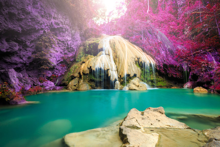 wonderful waterfall with colorful tree in thailand photo