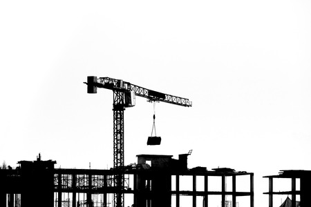 Construction site with cranes on silhouette background 版權商用圖片
