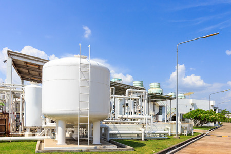 chemistry tank in factory with blue sky photo