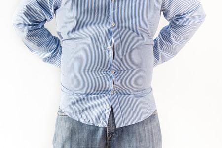 gordos: Hombre gordo en el fondo blanco Foto de archivo