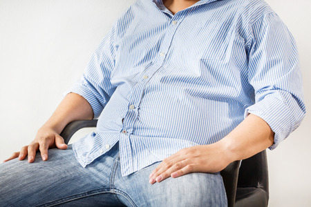 Fat man sitdown on white background