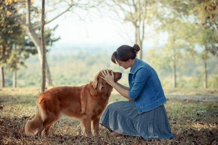 Beautiful woman with a cute golden retriver dog